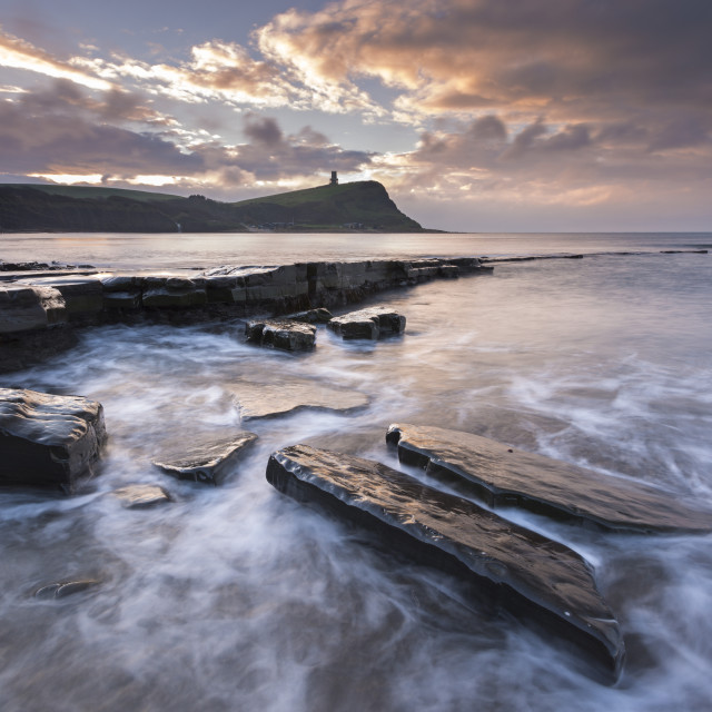 """Winter sunrise over Clavell Tower from Kimmeridge Bay on the Jurassic Coast,..."" stock image"