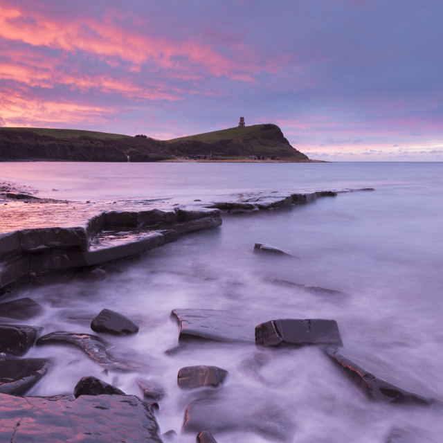 """Colourful dawn sky above Kimmeridge Bay in winter, on the Jurassic Coast,..."" stock image"