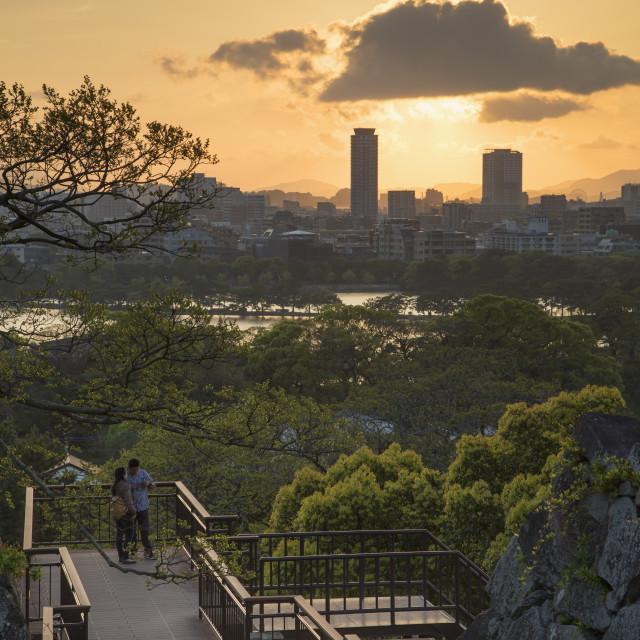 """Couple at Fukuoka Castle ruins at sunset, Fukuoka, Kyushu, Japan, Asia"" stock image"