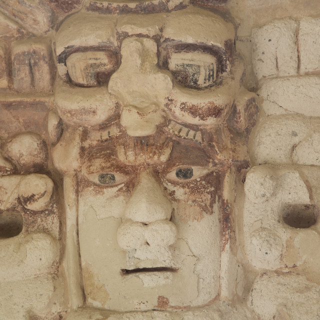 """Stone mask of Mayan Sun God Kinichna, taken through protective glass, Becan,..."" stock image"