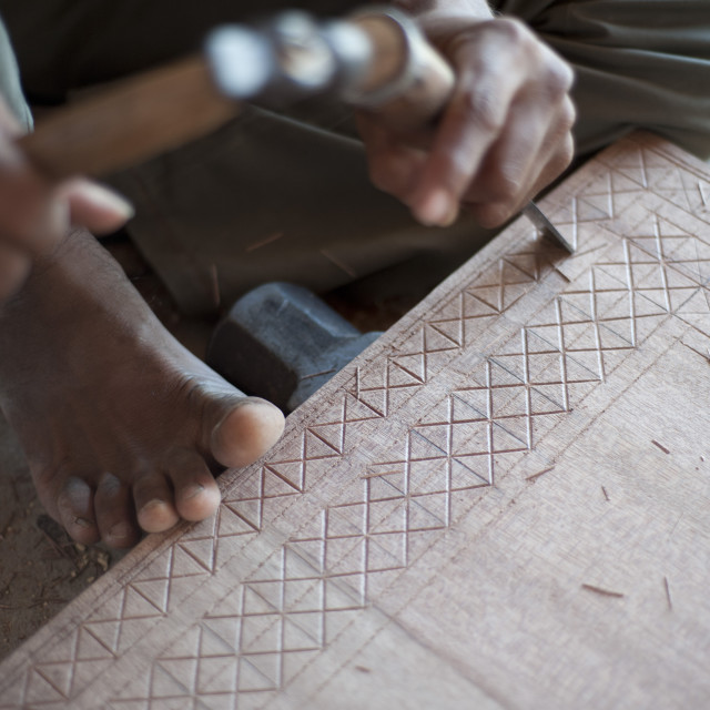 """Carpenter chiselling traditional pattern in a piece of wood ready for..."" stock image"