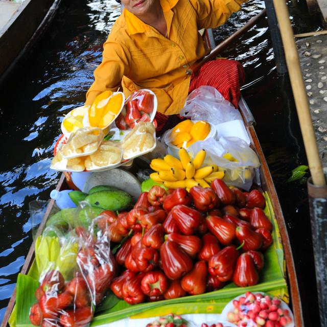 """Thai woman selling fruit at floating market, Bangkok, Thailand, Southeast..."" stock image"