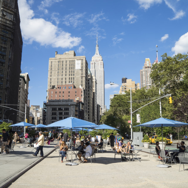 """""""People relaxing in the Flat Iron District, Empire State Building in view,..."""" stock image"""