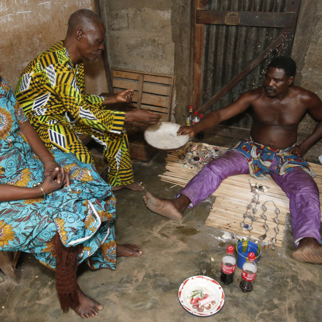 """Couple visiting a fortune teller in Ouidah, Benin, West Africa, Africa"" stock image"
