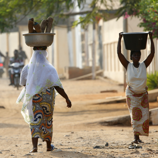 """African women carrying large bowls on their heads, Lome, Togo, West Africa,..."" stock image"