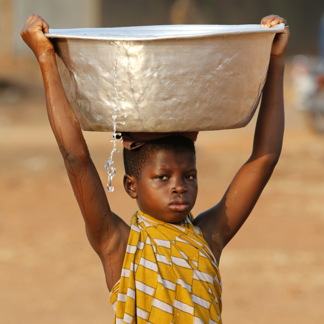 """""""Water chore in an African village, Togo, West Africa, Africa"""" stock image"""