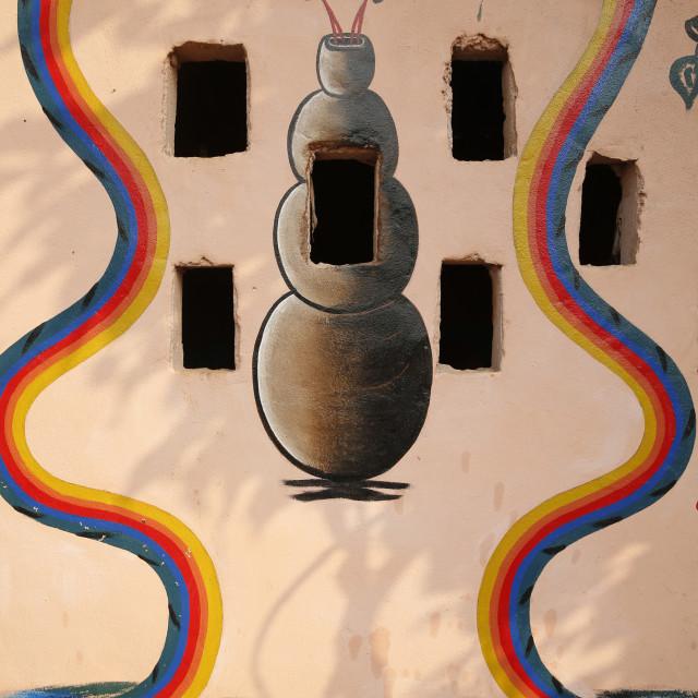 """Painting showing Aihou Edo rainbow snakes, gods of the universe, on a Voodoo..."" stock image"