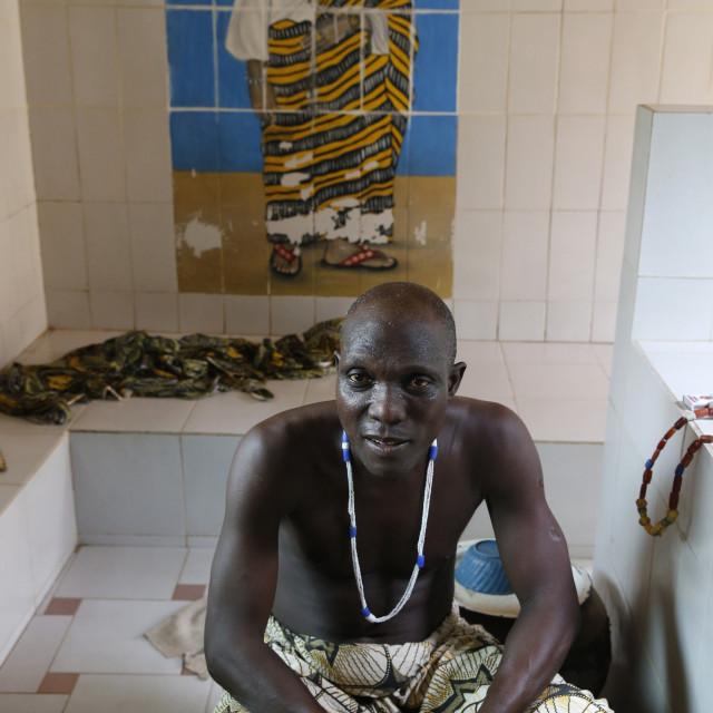 """Voodoo priest Emile Vignikin in Tron Pitourika temple in Ouidah, Benin, West..."" stock image"