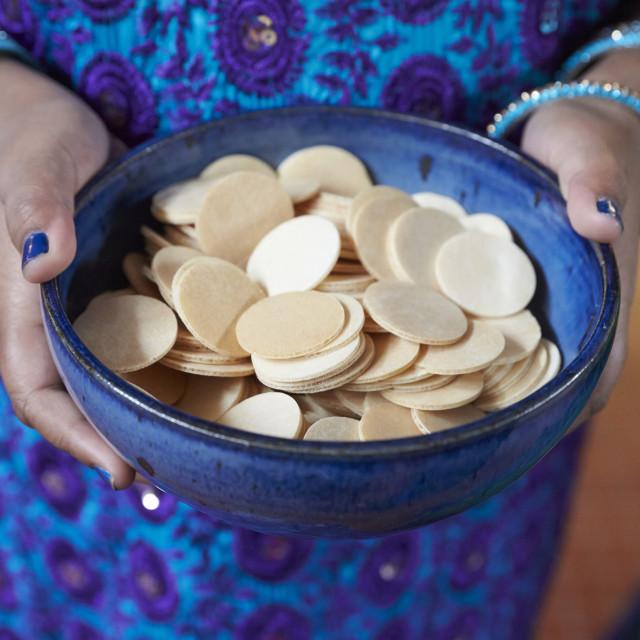 """Tamil catholic celebration in Antony, France. Host wafers."" stock image"