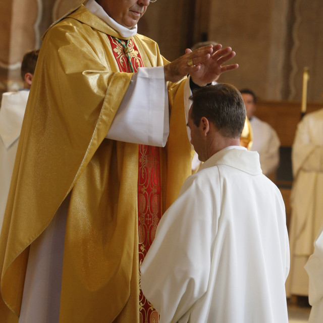 """Deacon ordinations in Sainte Genevieve's cathedral, Nanterre, France. Bishop..."" stock image"
