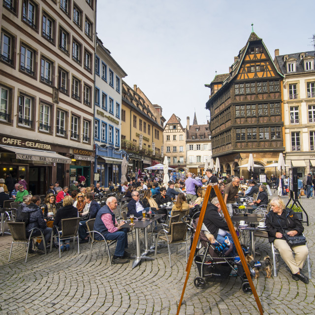 """People at outdoor cafe with Restaurant Maison Kammerzell in background at..."" stock image"