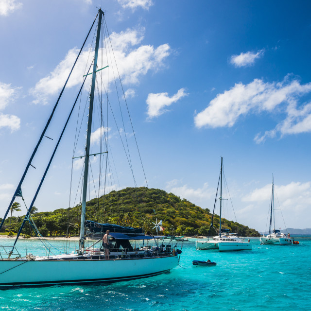 """Sailing boats anchoring in the Tobago Cays, The Grenadines, St. Vincent and..."" stock image"