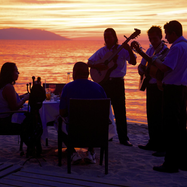 """""""Dinner on the beach in Downtown at sunset, Puerto Vallarta, Jalisco, Mexico,..."""" stock image"""