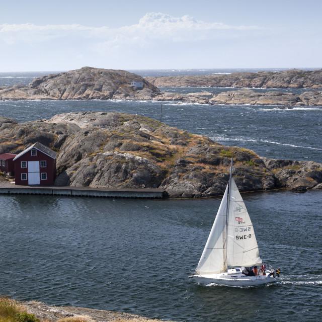 """Yacht sailing through islands of archipelago, Skarhamn, Tjorn, Bohuslan..."" stock image"