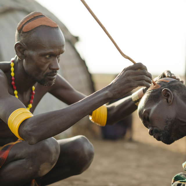 """""""Shuoloch applying clay hair decoration to Chafich, Dassanech Tribe, Salany..."""" stock image"""