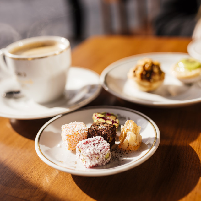 """""""Turkish delights (Lokum) on plate and coffee, Cafe near Spice Bazaar,..."""" stock image"""