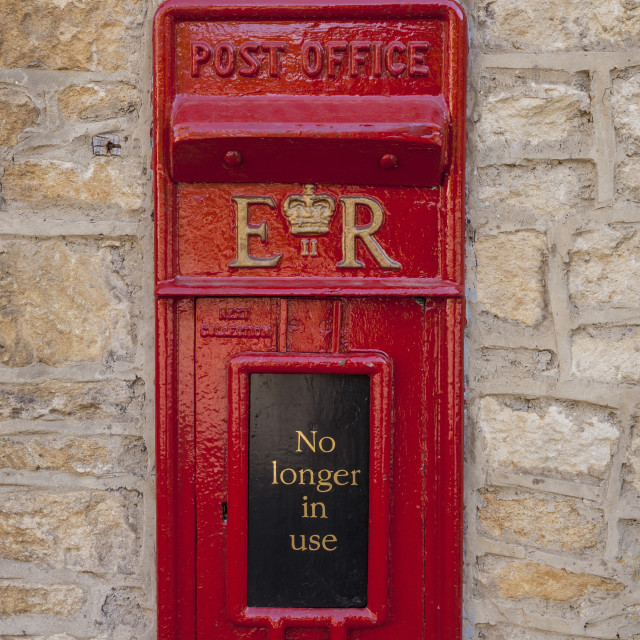 """""""An old postbox that is no longer in use at Castle Combe in Wiltshire."""" stock image"""