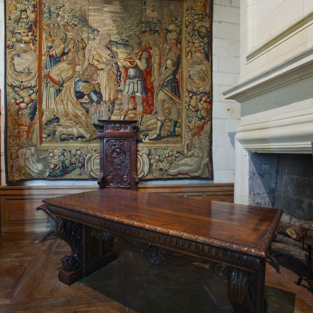 """A beautifully coloured tapestry and carved wooden table in the quarters of..."" stock image"