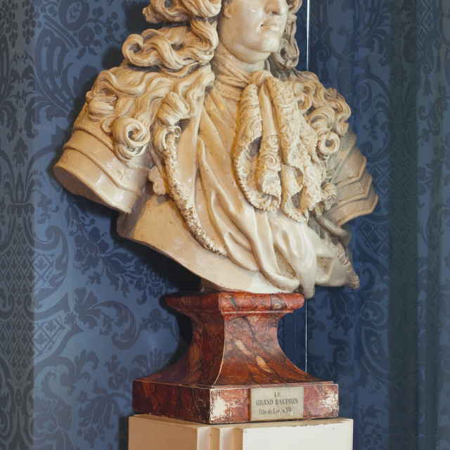 """A bust of the Grand Dauphin or Louis de France watches out of a window in the..."" stock image"