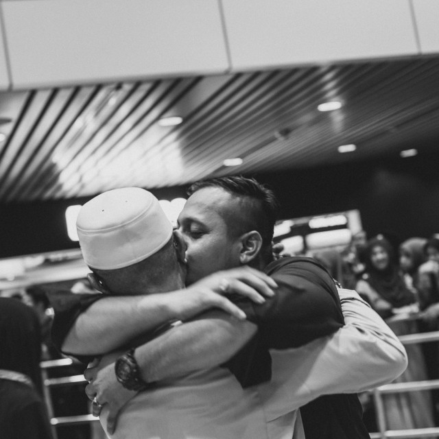 """Malaysia, Circa 2017 - A son welcomed his father home from Mecca"" stock image"