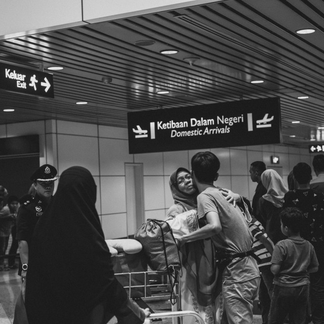 """Malaysia, Circa 2017 - A son welcomed his mother home from Mecca"" stock image"