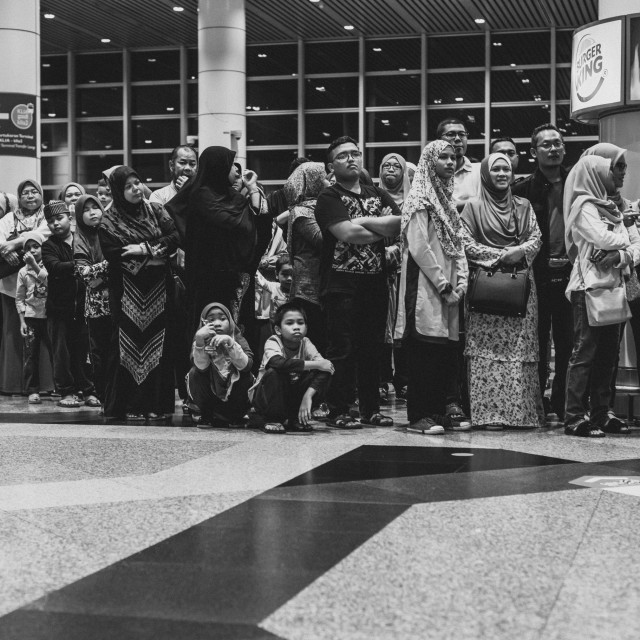 """Malaysia, Circa 2017 - Family members waiting for their loved on"" stock image"