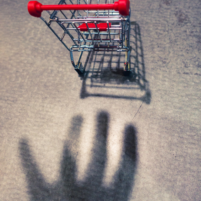"""Abstract - Hand Shadow Reaching for a trolley. Shopping conceptu"" stock image"
