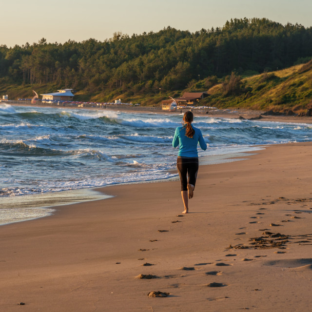 """""""Young sporty girl running on beach"""" stock image"""