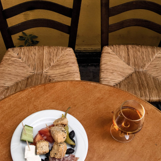 """""""Greek Food and Drink. Glass of Brandy and Meze, Chania Old Town, Crete, Greece"""" stock image"""
