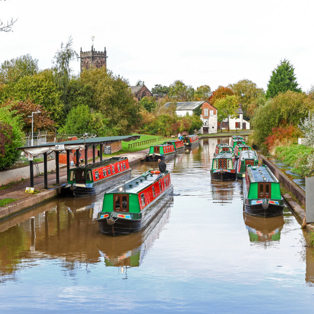 """Canal boats or barges on the Trent and Mersey Canal at Middlewic"" stock image"