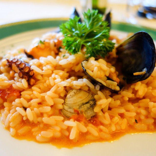 """A plate of seafood food risotto with rice mussels squid calamari"" stock image"