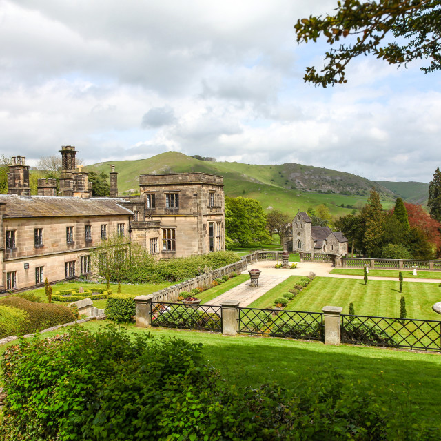 """Ilam Hall and gardens with Church Of The Holy Cross in the backg"" stock image"