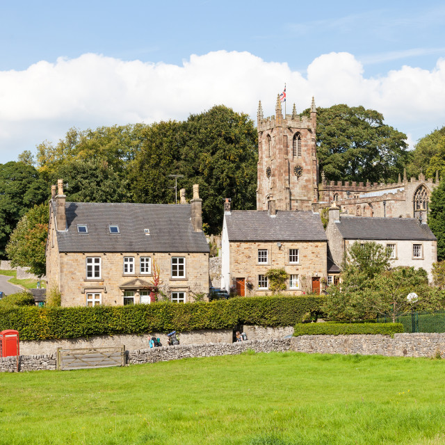 """St. Giles Parish church and the village of Hartington, Derbyshir"" stock image"