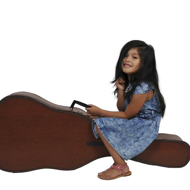 """Girl with Guitar Case"" stock image"