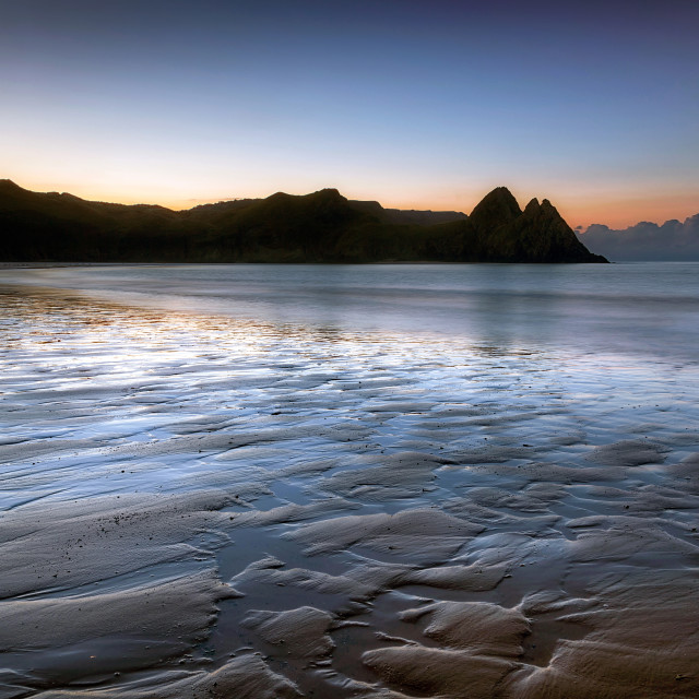 """Daybreak at Three Cliffs Bay"" stock image"