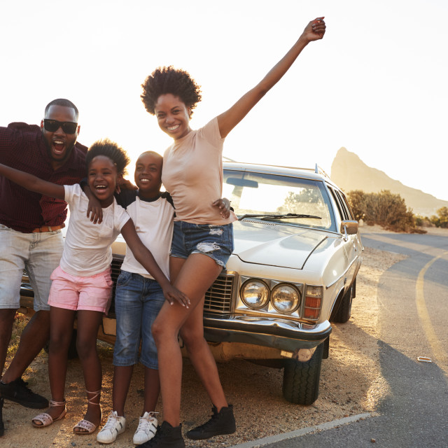 """""""Portrait Of Family Standing Next To Classic Car"""" stock image"""