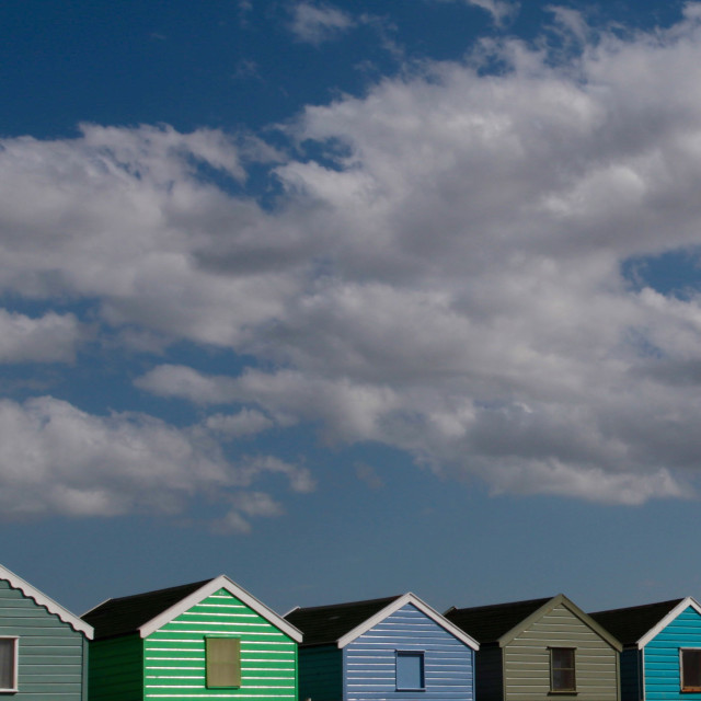 """Beach huts and sky"" stock image"