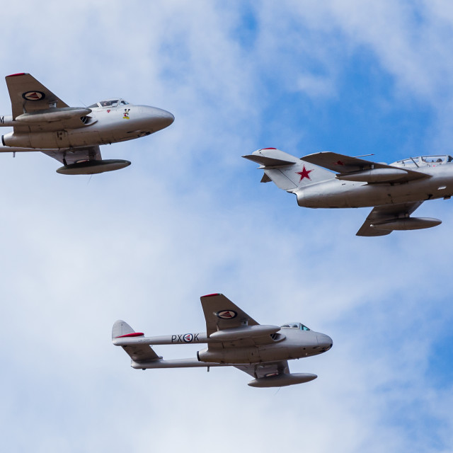 """""""Vampire pair in formation with a Mig-15"""" stock image"""