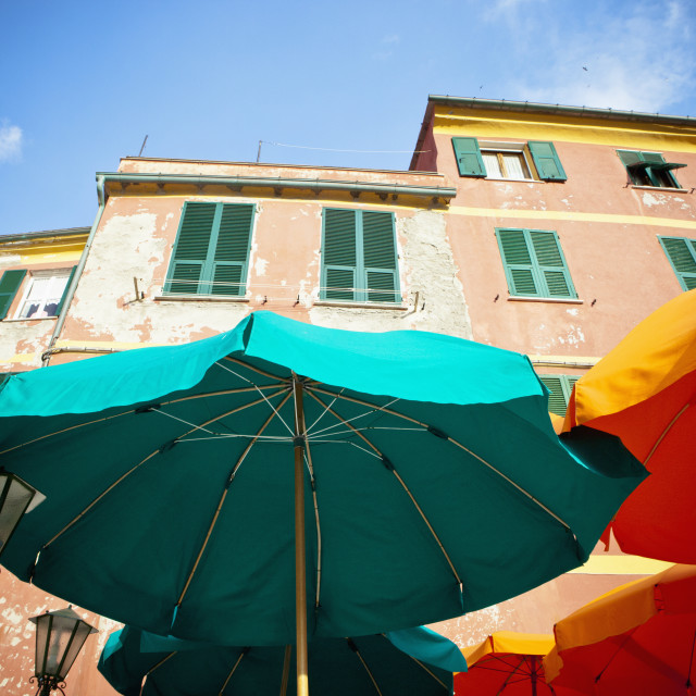 """Green And Yellow Patio Umbrellas Beside A Building; Vernazza, Liguria, Italy"" stock image"