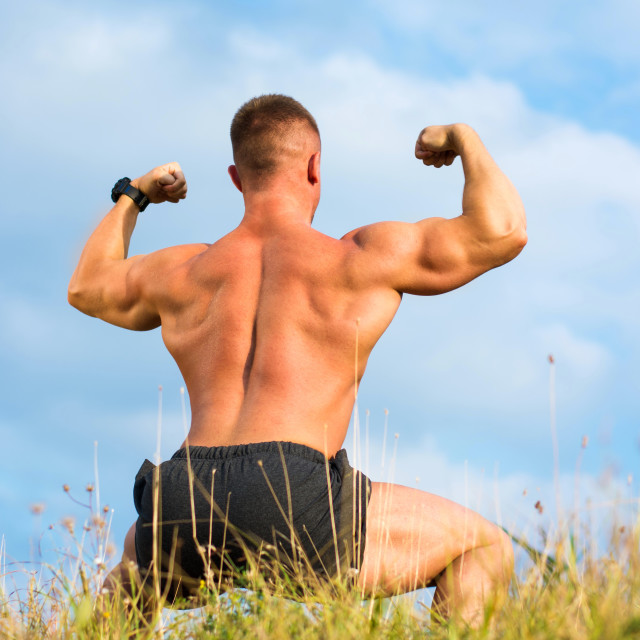 """""""Bodybuilder flexing back muscles outdoors"""" stock image"""