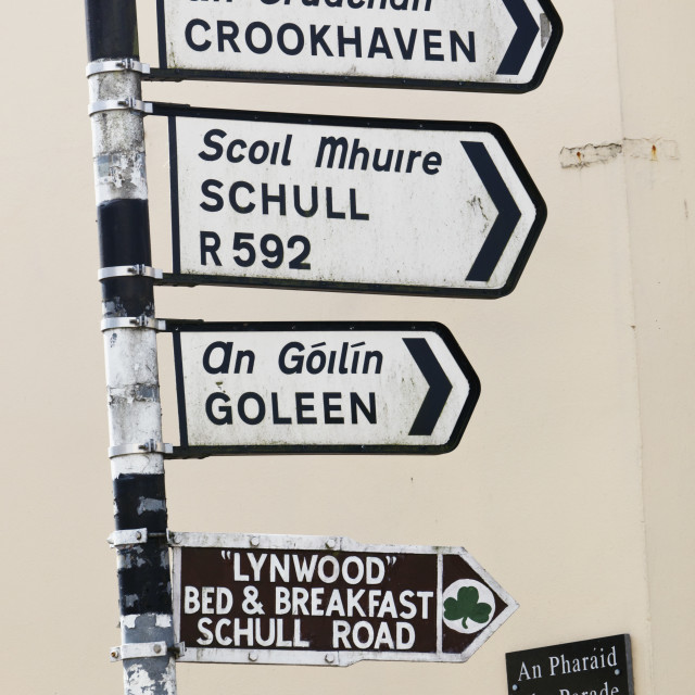 """Bilingual Sign Post In Irish And English Languages; Ballydehob,County Cork,..."" stock image"