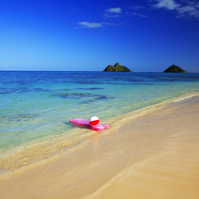 """Hawaii, Oahu, Lanikai, Pink Inflated Raft And Beachball On Clear Ocean Water,..."" stock image"