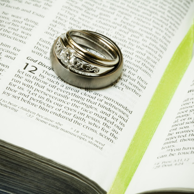 """""""Wedding Rings Placed On A Page Of The Bible; Grand Junction, Colorado, United..."""" stock image"""
