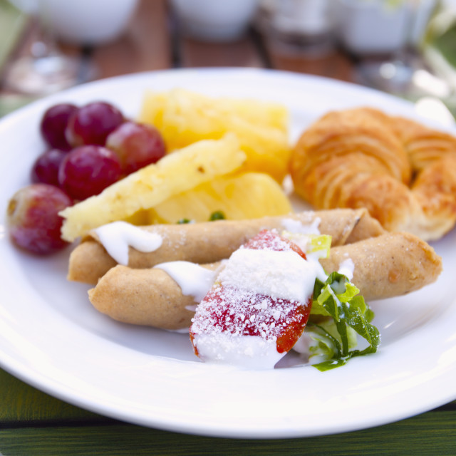 """""""Fruit Crepe And Croissant On A White Plate; Puerto Vallarta, Mexico"""" stock image"""
