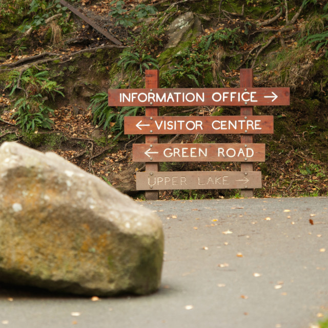 """""""A Wooden Directional Sign For An Information Office And Visitor Centre; Ireland"""" stock image"""
