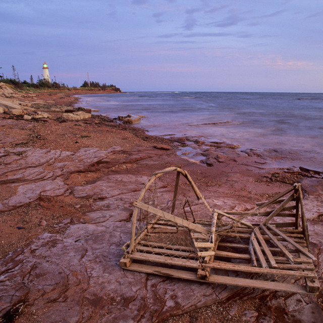 """""""Point Prim Lighthouse And Old Lobster Trap, Sunset, Prince Edward Island, Canada"""" stock image"""