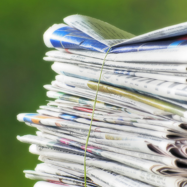 """Newspapers Tied Into A Pile For The Recycle Bin."" stock image"