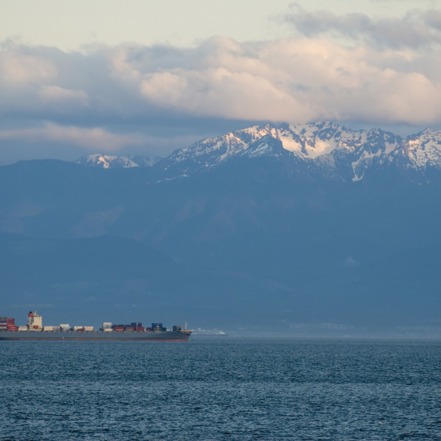 """""""Large Container Ship In Front Of Snow-Capped Mountains, Victoria, Bc, Canada"""" stock image"""