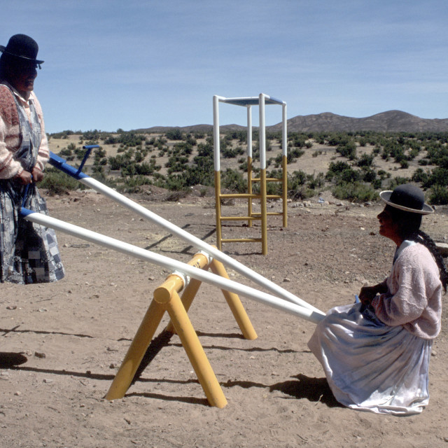"""Young women playing See-Saw in the Altiplano region, Bolivia."" stock image"