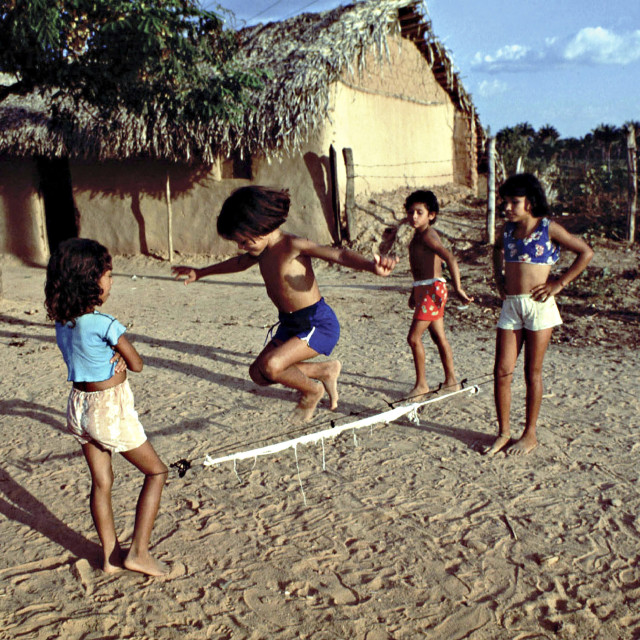 """BRAZIL GIRLS SKIPPING A ROPE IN A LANDLESS PEASANT SETTLEMENT. MARANHAO..."" stock image"